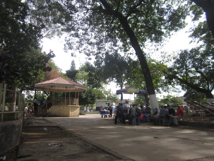 Parque Colon with it's broken benches, sleeping dogs, $1 haircuts and cervecerias; a poor man's Parque Libertad.